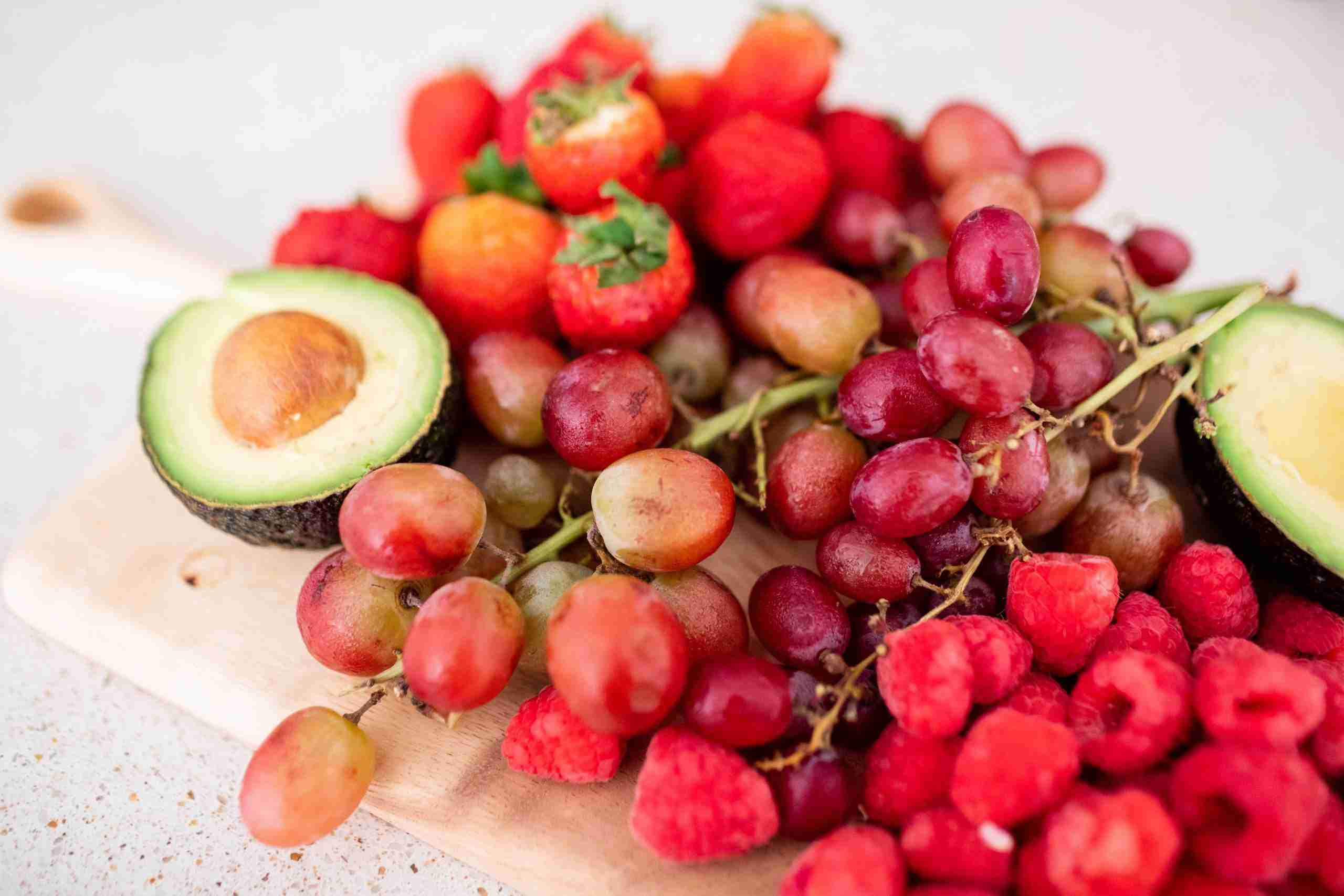 Picture of strawberries, grapes, raspberries, and avocado.